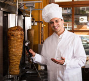Chef cutting meat for kebab Royalty Free Stock Photos