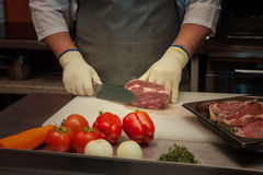 Chef cutting meat Stock Photo
