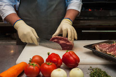 Chef cutting meat Stock Image
