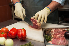 Chef cutting meat Stock Photos