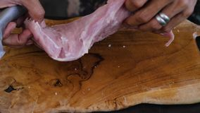 Knife hand cuts meat stock footage