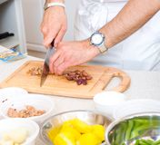Chef cutting the olives Royalty Free Stock Images