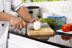 Chef cutting onion for making Hamburger Stock Photography