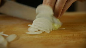 Chef cutting onion. stock video footage