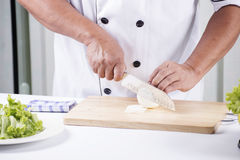 Chef cutting the onion Royalty Free Stock Image
