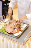 Chef Cutting Pork Royalty Free Stock Image