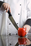 Chef Cutting Red Pepper Stock Photo