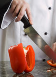 Chef Cutting Red Pepper Stock Photos