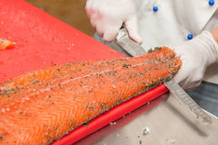 Chef Cutting salmon fish Royalty Free Stock Image