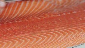 Chef cutting the salmon, preparing salmon stock video
