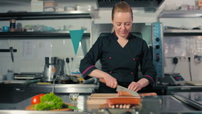 Chef cutting sausages. And frankfurters stock video footage