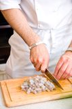 Chef cutting the shrimp Royalty Free Stock Images