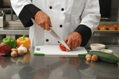 Chef cutting vegetables Royalty Free Stock Images