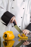 Chef Cutting Yellow Pepper Royalty Free Stock Image