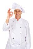 Chef dans le chapeau blanc avec le signe parfait Image libre de droits