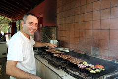 Chef de sourire de barbecue Photos libres de droits