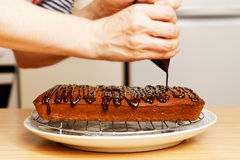 Chef decorate the cake with chocolate Stock Photos