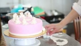 Chef decorate the cake. stock video