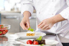 Chef decorate dessert cake with lemon leaf Stock Photography