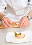 Chef decorate plate Royalty Free Stock Photography