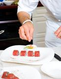 Chef decorate plate Stock Photography
