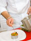 Chef decorate plate Stock Photos