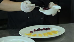Chef decorate plate sauce stock video