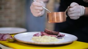 Chef decorate plate with steak stock video footage