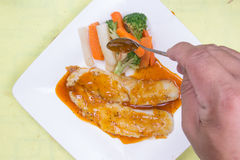 Chef decorated fish Steak with Orange sauce Stock Images