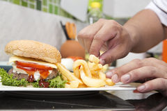 Chef decorated Hamburger and French Freid Stock Image