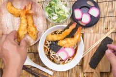 Chef decorated tempura udon with shrimp tempura. / Cooking Tempura Udon concept stock photos