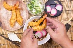 Chef decorated tempura udon with shrimp tempura. / Cooking Tempura Udon concept royalty free stock photos
