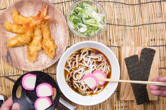 Chef decorated tempura udon wth dried seaweed. / Cooking Tempura Udon concept royalty free stock photos