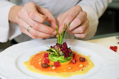 Chef is decorating appetizer Royalty Free Stock Photo