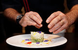 Chef is decorating appetizer with flowers Stock Images