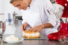 Chef decorating cream Royalty Free Stock Image
