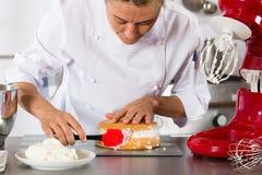 Chef decorating cream Stock Photo
