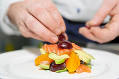 Chef is decorating delicious dish Stock Photos
