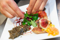 Chef is decorating dish Royalty Free Stock Photo