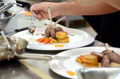 Chef is decorating grilled rack of lamb Royalty Free Stock Images