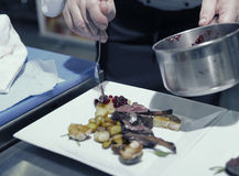 Chef is decorating grilled rack of lamb Stock Photography