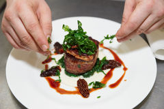 Chef is decorating steak Stock Photo