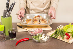 Chef demonstrates fried quail carcass Stock Images