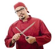 Chef, der ein Messer schärft Stockbilder