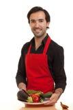 Chef, der Gemüse darstellt Stockbild