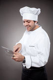 Chef with digital tablet Stock Images