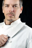 Chef Displays Knife, portrait Photos libres de droits