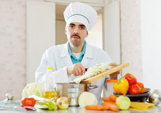 Chef does veggie lunch at kitchen Royalty Free Stock Photography
