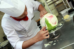 Chef doing carving Royalty Free Stock Photo