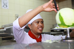 Chef doing carving. Portrait of chef doing carving Royalty Free Stock Image